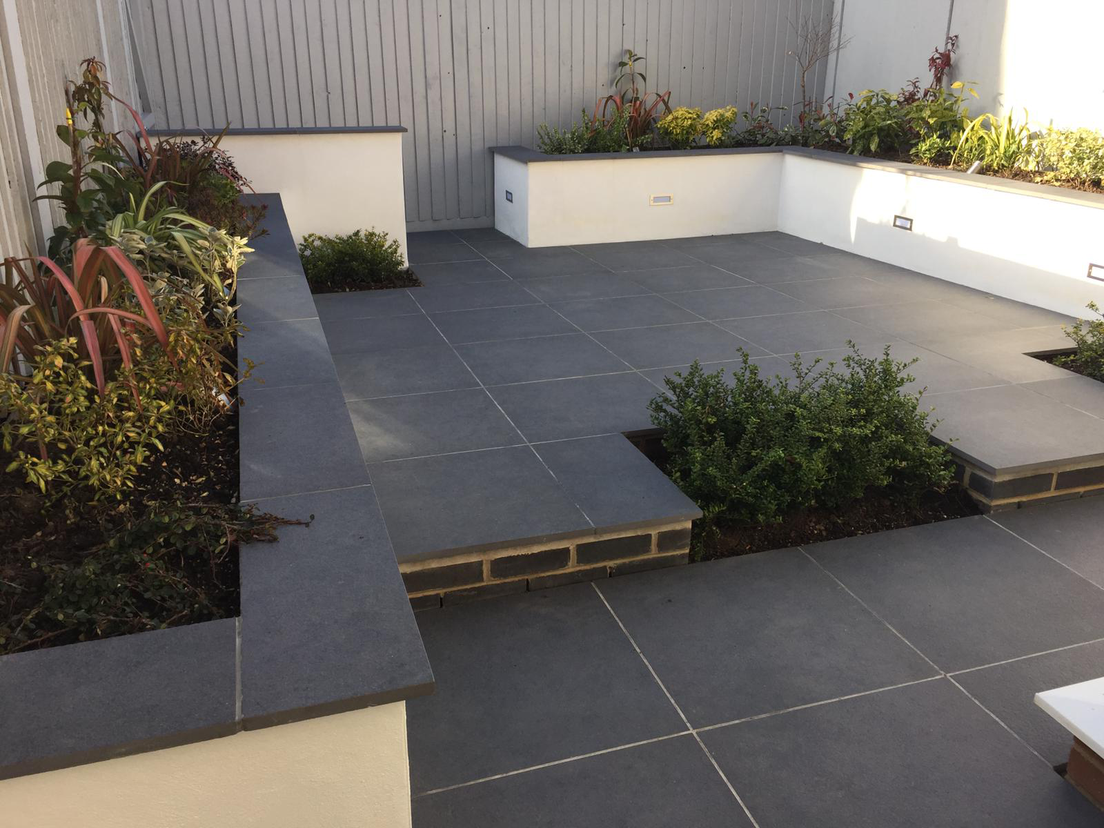 Paving slabs and raised borders - Landscaping Services
