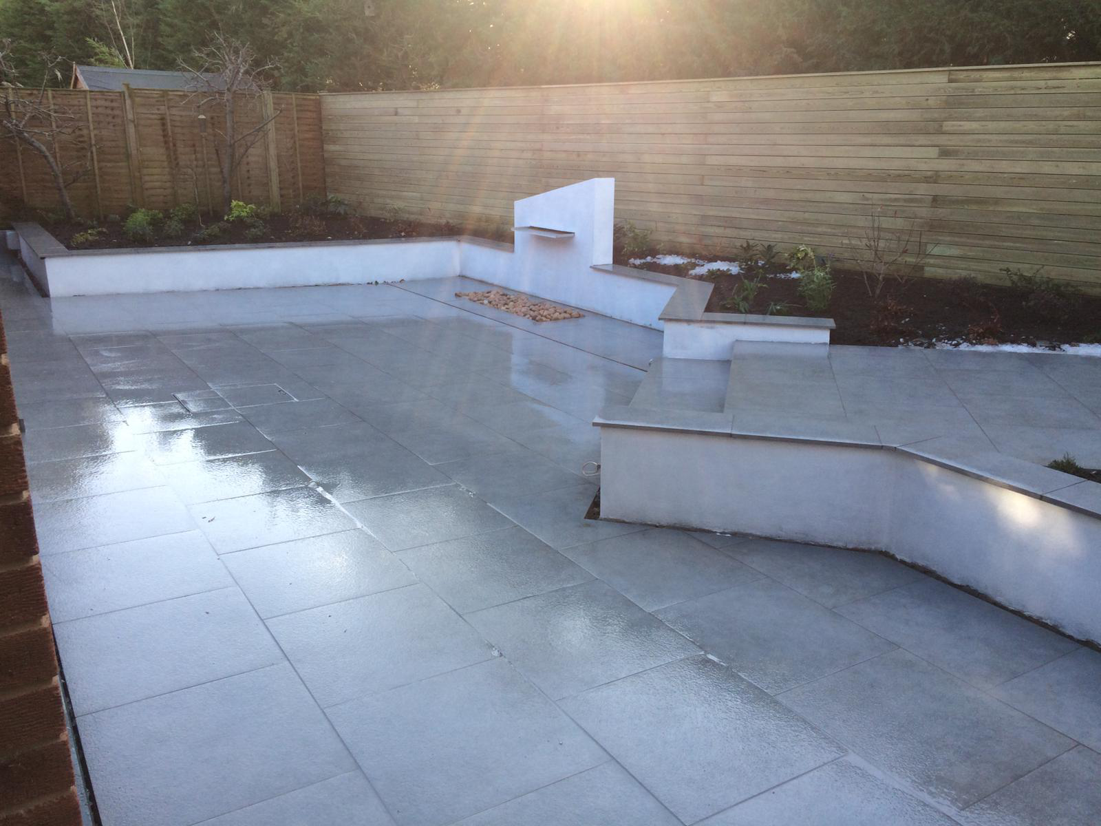 Paving slabs with water feature - Landscapes portfolio by Martyn Powell Landscapes in Cheltenham