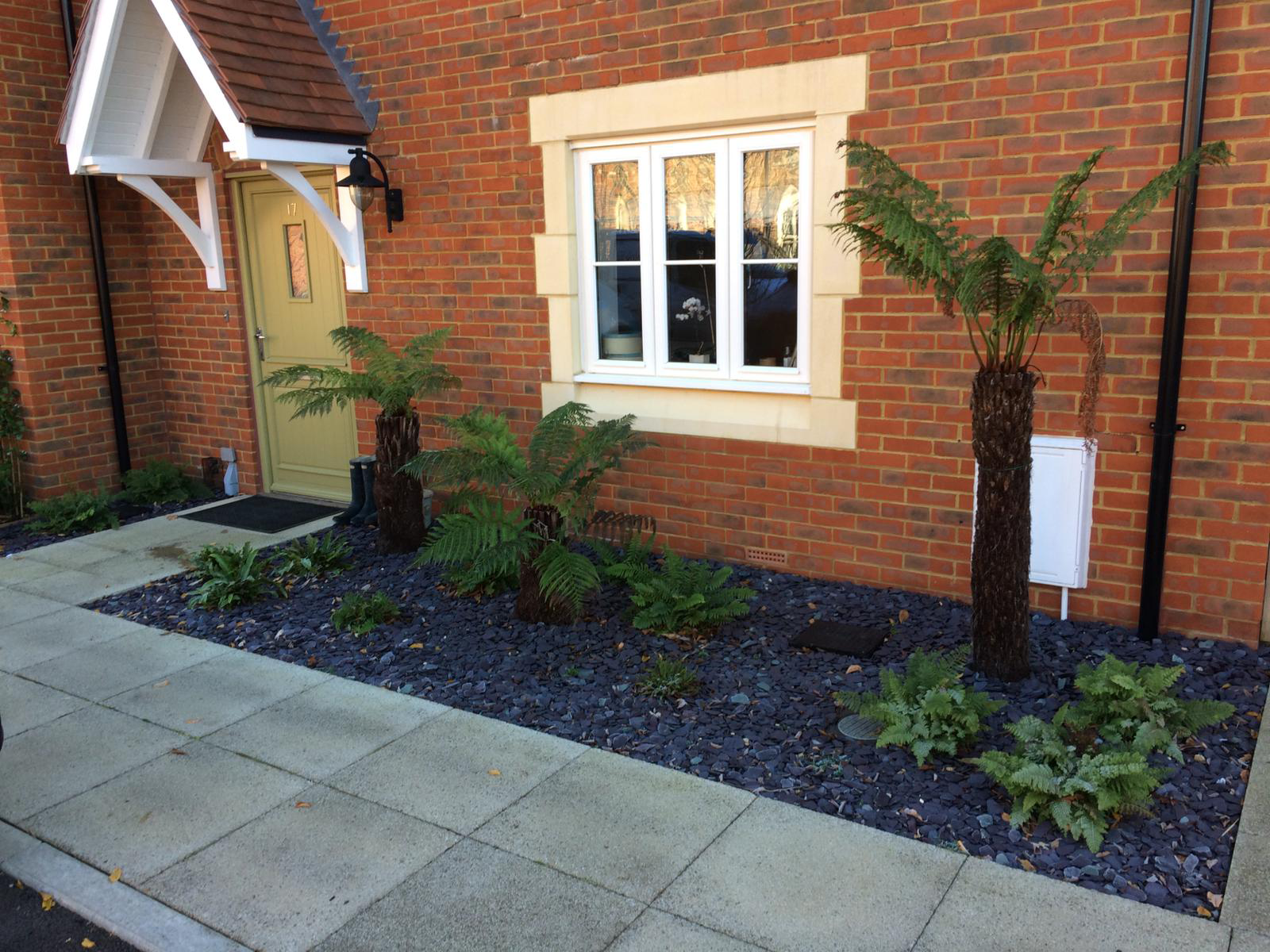 Front garden design with gravel and paving
