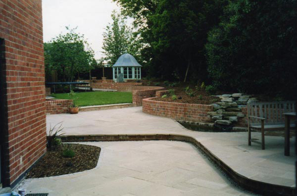 Landscaping with summer house and pond - Period front garden - Grey slabs with raised beds - Landscaping large garden - Landscapes portfolio by Martyn Powell Landscapes in Cheltenham
